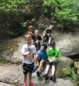 Campers have fun out on the rocks